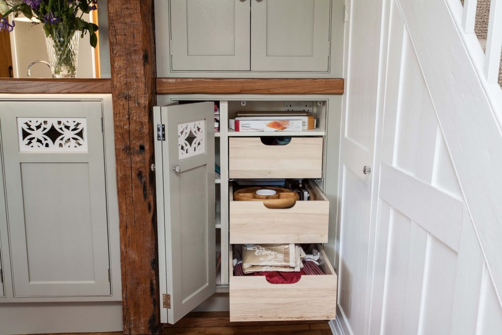 custom cupboard for irregular cavity