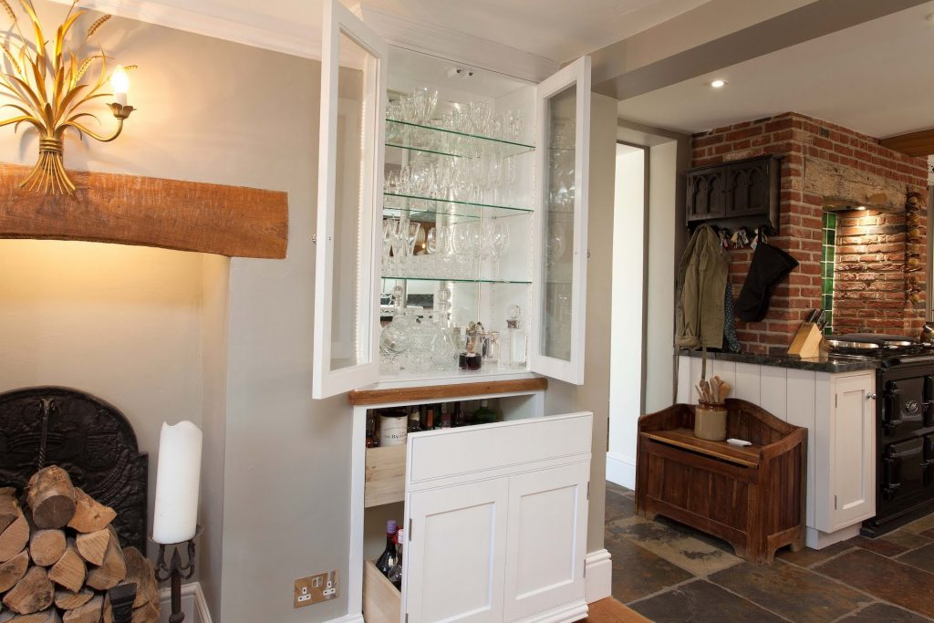 custom built glass fronted cabinet
